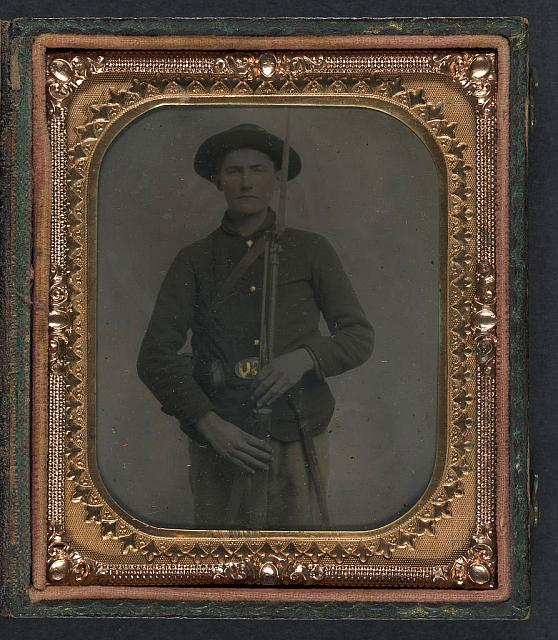 [Unidentified soldier in Union uniform and slouch cap with bayoneted musket, cap box, cartridge box, and bayonet scabbard]