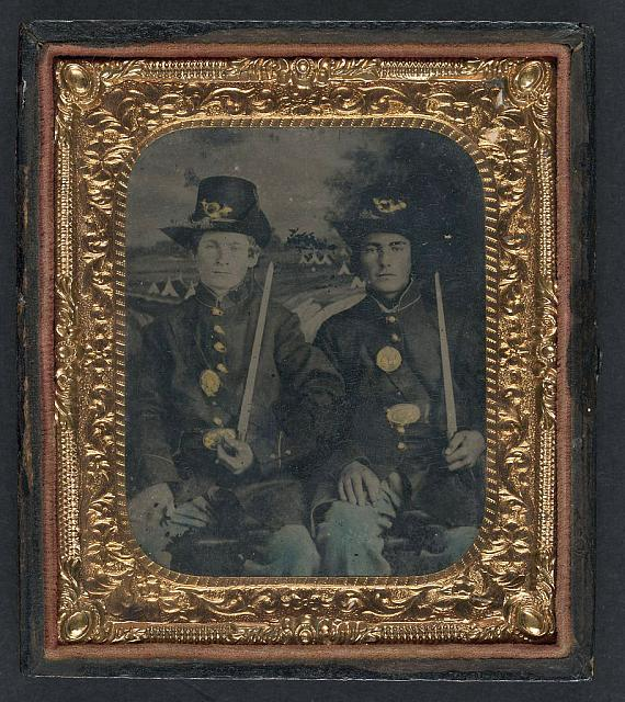 [Two unidentified young soldiers in Union sack coats and Hardee hats with bayonets]
