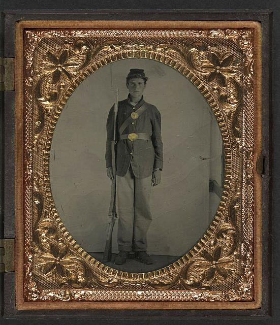 [Unidentified young soldier in Union sack coat and forage cap with bayoneted musket]