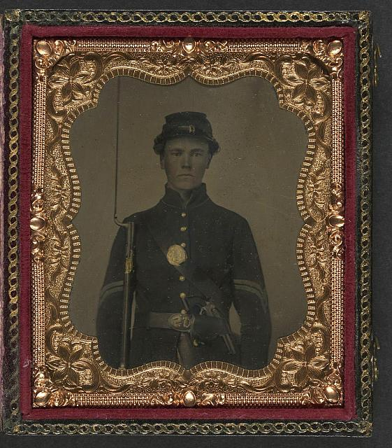 [Unidentified young soldier in Union corporal's uniform with bayoneted musket]