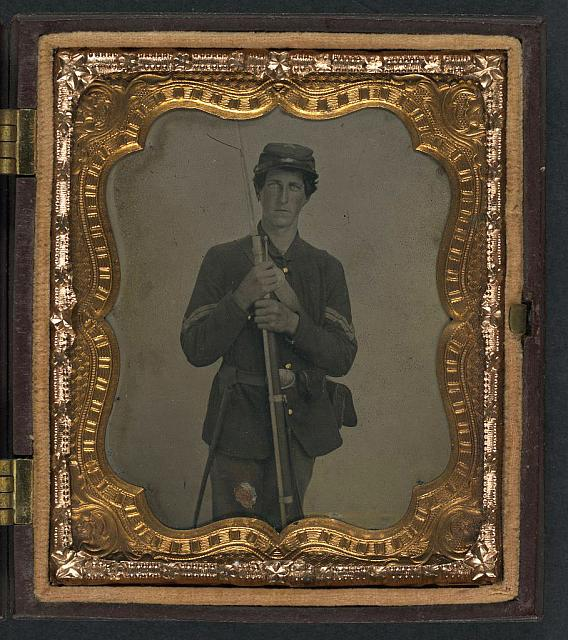 [Unidentified soldier in Union corporal's sack coat with bayoneted musket]