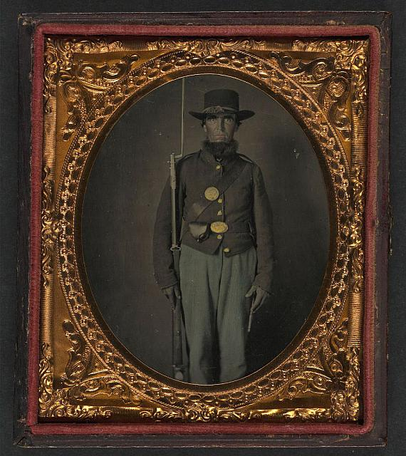 [Unidentified soldier in Union uniform and planter hat with bayoneted musket, cap box, and scabbard]