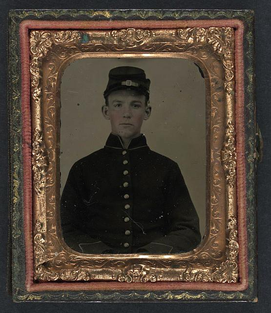 [Unidentified young soldier in Union shell jacket and forage cap]