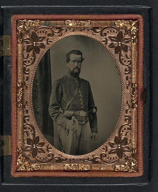 [Unidentified soldier in Union uniform with cavalry sword]