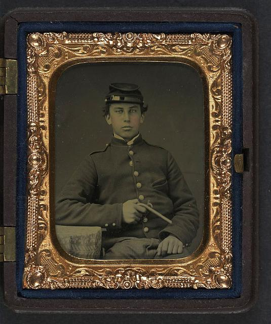 [Unidentified soldier in Union uniform and forage cap with pistol]