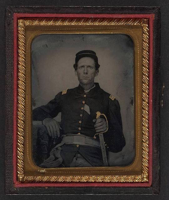 [Unidentified soldier in Union captain's uniform with artillery saber]