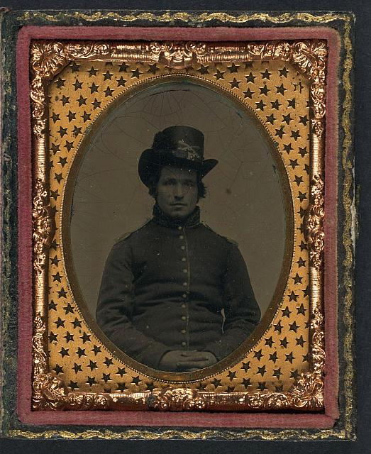 [Unidentified young Union soldier in infantry shell jacket with shoulder scales and Company E Hardee hat]