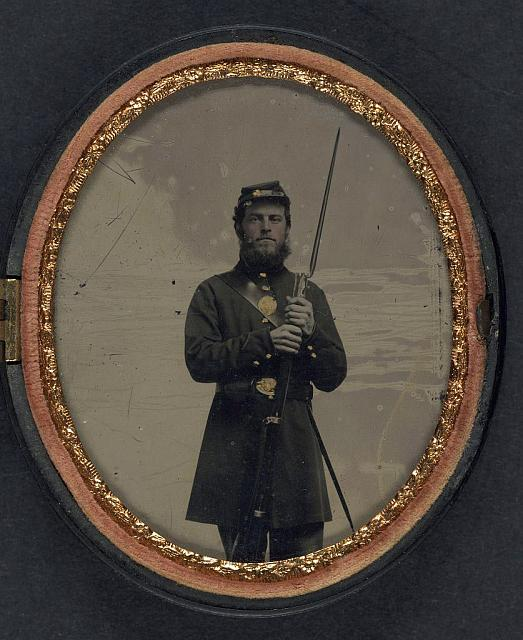 [Unidentified soldier in Union uniform with bayoneted musket and scabbard]