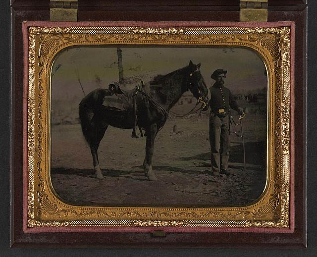 [Unidentified soldier in Union uniform with saber and horse]