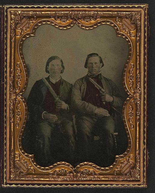 [Two unidentified soldiers in non-regulation Confederate uniforms with single shot pistol and Colt Army Model 1860 revolver]
