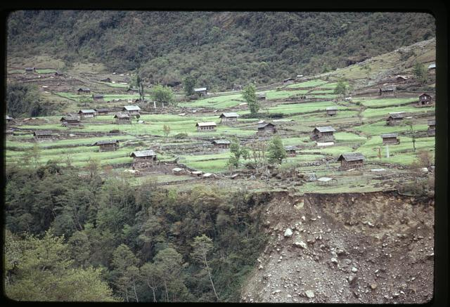 [Landslide by mountain village in northern Sikkim]