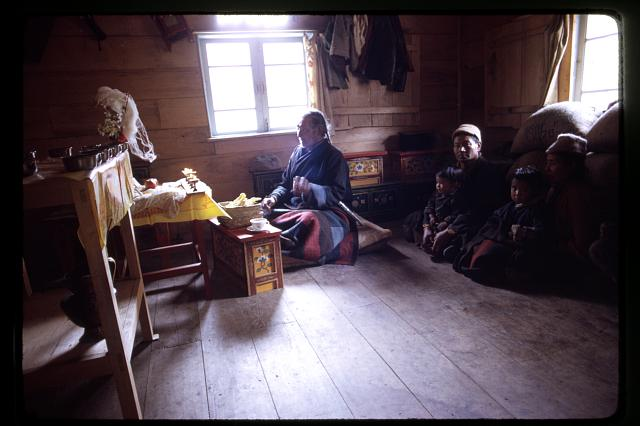 [Family of sick girl with Poh, a shaman, during a religious ritual to heal the child]