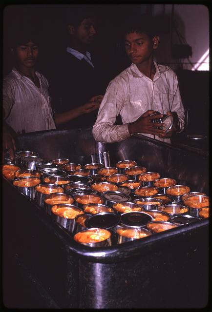 [Young men processing oranges at fruit canning factory, Sikkim]