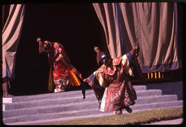 [Masked ceremonial dancers entering the stage at the New Year's ceremony, Sikkim]