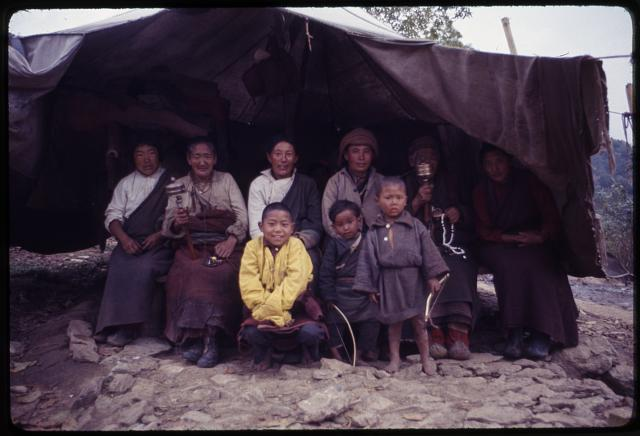 Traveling Tibetan tribe, grandmothers spinning prayer wheels
