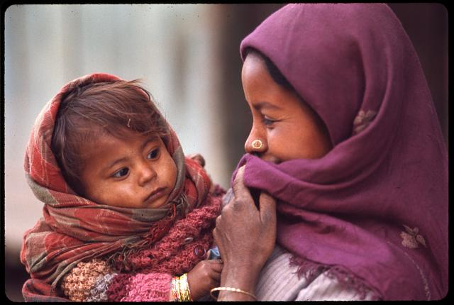 [Nepalese woman wearing purple headscarf and nose ring, holding baby, Sikkim]