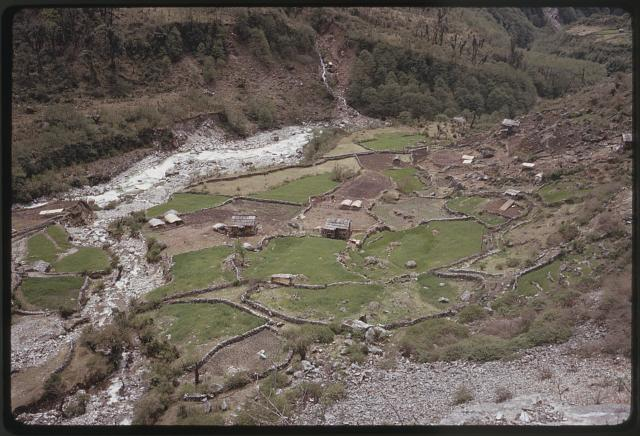 [Small buildings and terraces in a valley next to a river, Lachung, Sikkim]