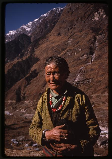 [Woman, half-length portrait, standing, facing front, wearing necklace, Lachung, Sikkim]