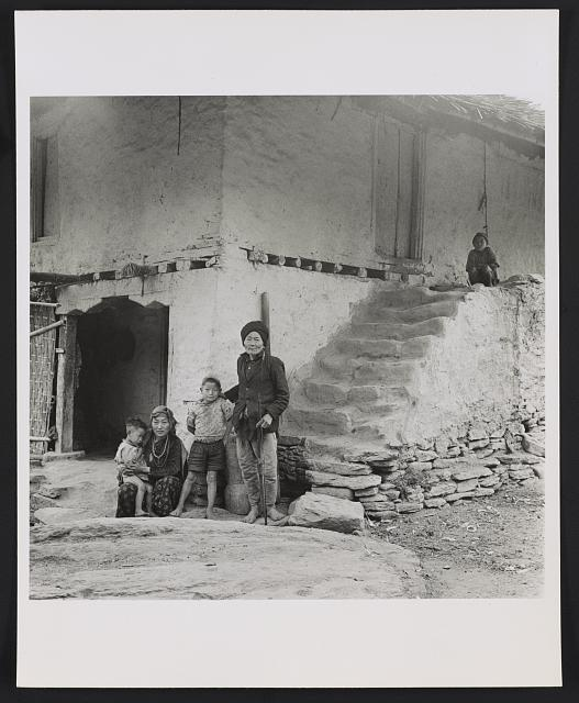 [Kiranti family, posed in front of house, Sikkim]
