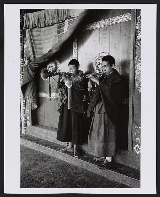 [Lamas blowing gyalings at temple door, Sikkim]