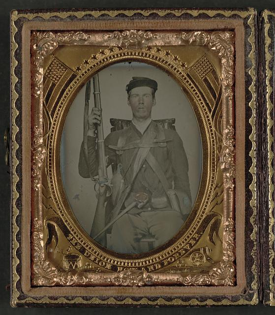 "[Unidentified infantry soldier in Union uniform in full marching order with musket, canteen, cartridge box, cup, knife, knapsack, and cap box with initials ""W.H.W.""]"
