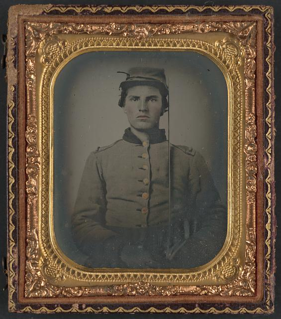 [Unidentified soldier in Confederate uniform with cavalry sword]