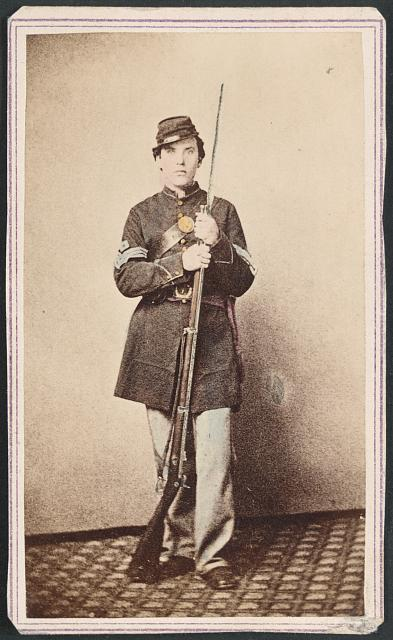 [Sergeant Cornelius V. Moore of Company B, 100th New York Volunteers, a sergeant of 39th Illinois Regiment, a corporal of 106th New York Volunteers, and a private of the 11th Vermont Regiment holding bayoneted musket]