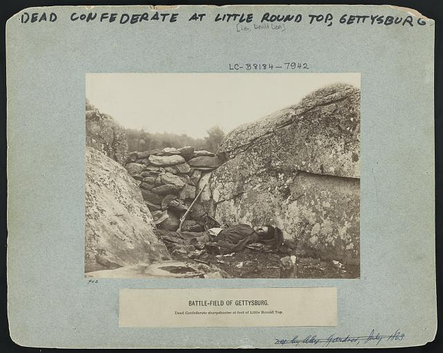 Battle-field of Gettysburg--Dead Confederate sharpshooter at foot of Little Round Top [i.e., Devil's Den]