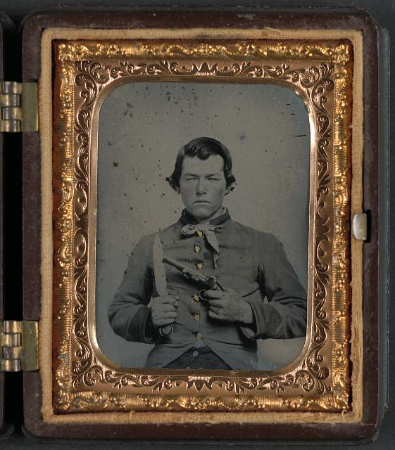 [Unidentified soldier in Confederate uniform with bowie knife and single shot pistol]