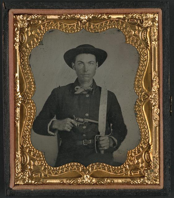 [Unidentified soldier in Confederate uniform and round hat with Baby Colt Dragoon revolver and D-guard Bowie knife]