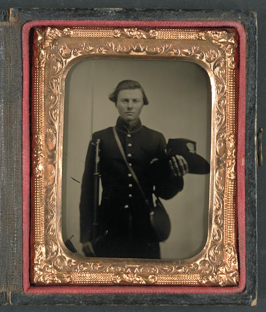 [Unidentified soldier in Union uniform with bayoneted musket, canteen, and Hardee hat]