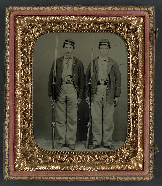 [Two unidentified soldier in Union uniforms with bayoneted muskets and pistols]