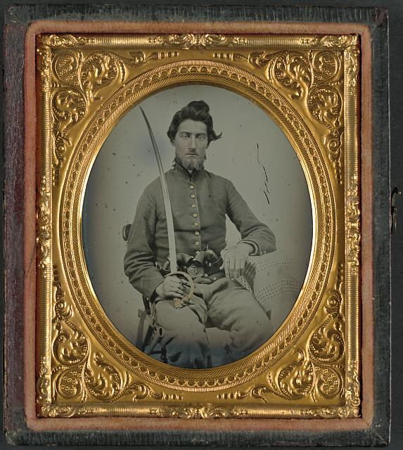 [Felix Thompson of Company H, 1st Missouri Cavalry Regiment with pistols and sabre]