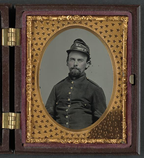 [Unidentified soldier in Confederate uniform and Richmond Howitzers artillery unit hat]