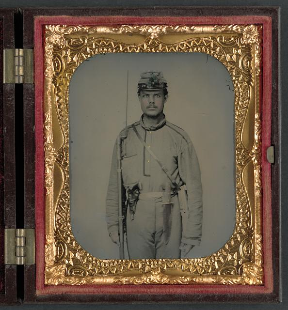 [James W. Millner of Company K, 38th Virginia Infantry Regiment with bayoneted musket, holstered pistol, and knife]
