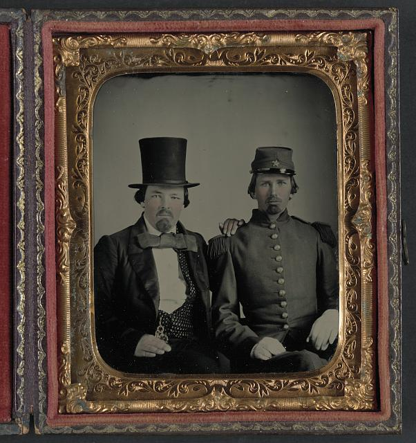 [Unidentified soldier in Confederate uniform and unidentified man, possibly the soldier&#39;s father]