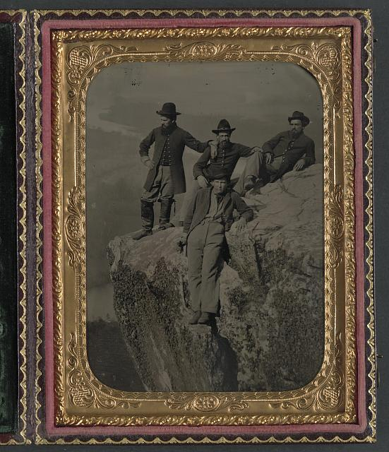 [Private Henry McCollum of Company B, 78th Pennsylvania Infantry Regiment and three unidentified soldiers in 78th Pennsylvania Infantry uniforms at Point Lookout, Tennessee]