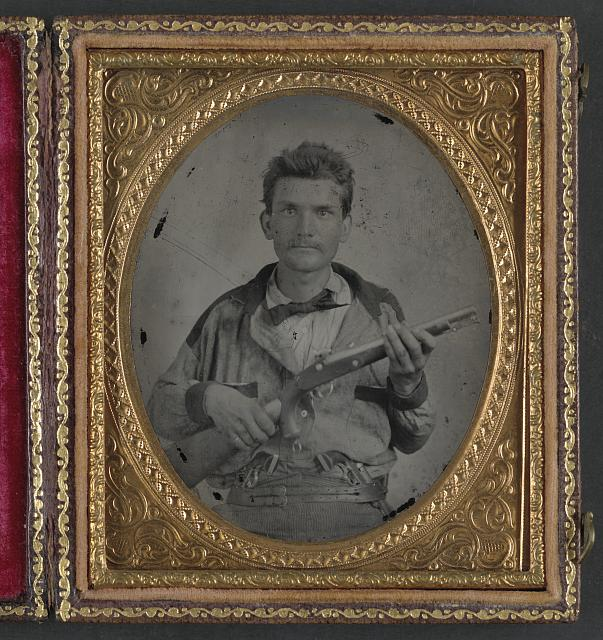 [Unidentified soldier in Confederate uniform with 1855 Springfield pistol carbine and pistols]