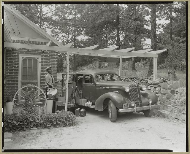 Frances B. Johnston's car and Huntley [Ruff] at the Wheel Inn, Morganton, N.C.