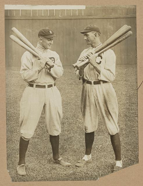 [Ty Cobb, Detroit, and Joe Jackson, Cleveland, standing alongside each other, each holding bats]