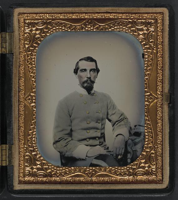 [Unidentified soldier in Confederate double-breasted frock coat with single row of braid denoting the rank of lieutenant]
