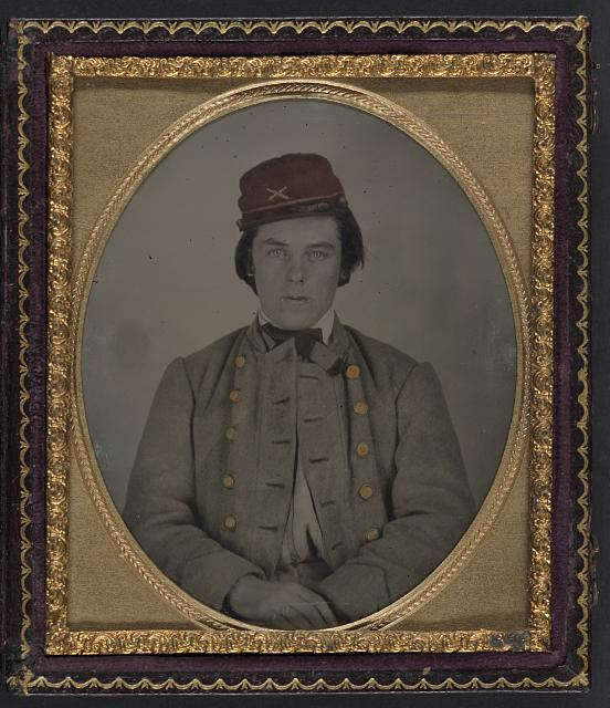 [Unidentified artillery soldier in Confederate uniform and kepi hat]