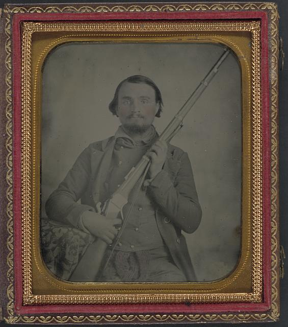 [Third Lieutenant John Alphonso Beall of Company D, 14th Texas Cavalry Regiment, with Berdan Sharps rifle]