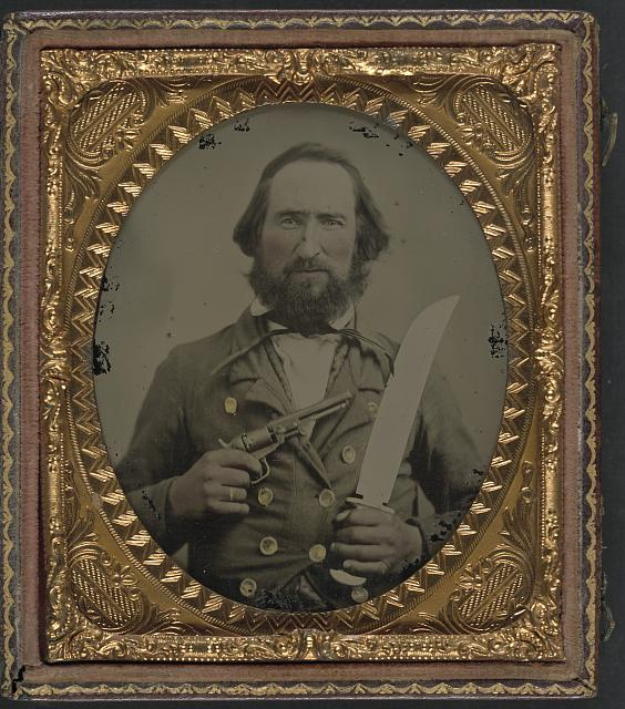 [Unidentified soldier in Confederate uniform with large Bowie knife and revolver]