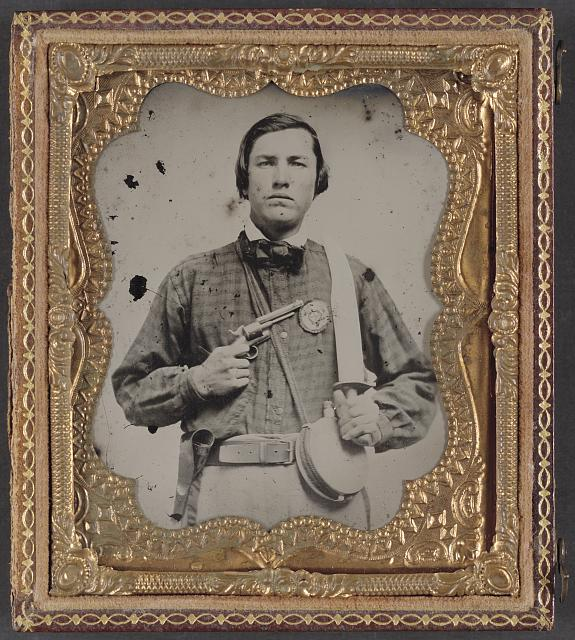 [Private David C. Colbert of Company C, 46th Virginia Infantry Regiment, with secession badge, canteen, pistol, and Bowie knife]