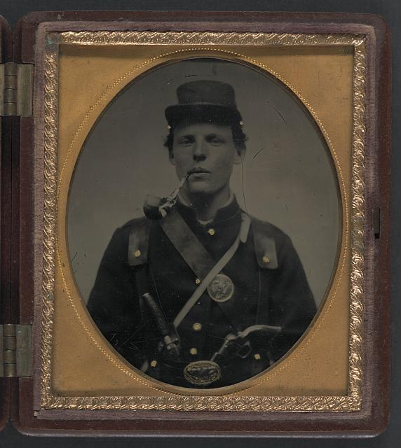[Unidentified soldier in Union uniform and state of New York belt buckle with revolver and side knife and smoking pipe]