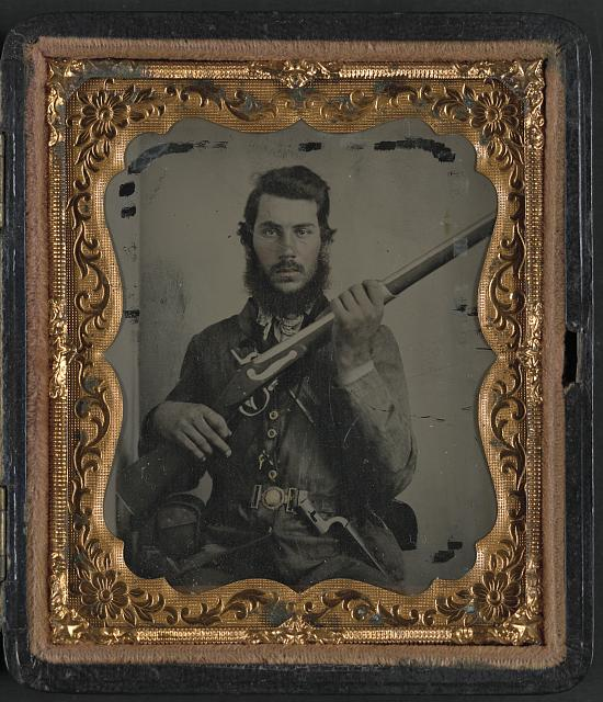 [Sergeant James Bishop White of Company B, 60th Tennessee Infantry Regiment, in shell jacket with M1816/22 musket, bayonet, and Enfield cartridge box and unidentified man, possibly Jasper White, in civilian clothing]