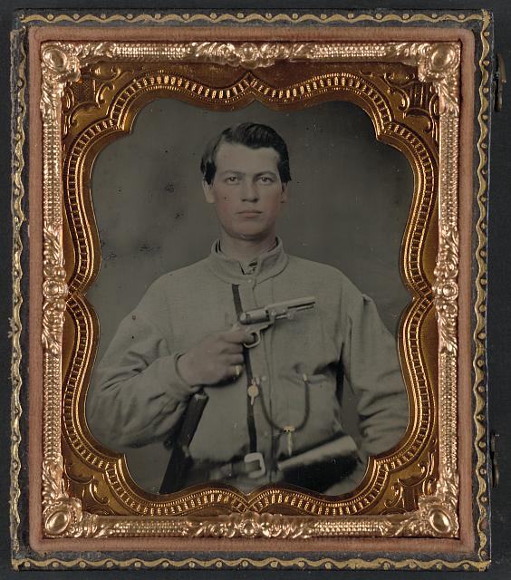 [Unidentified soldier in Confederate uniform with gun]