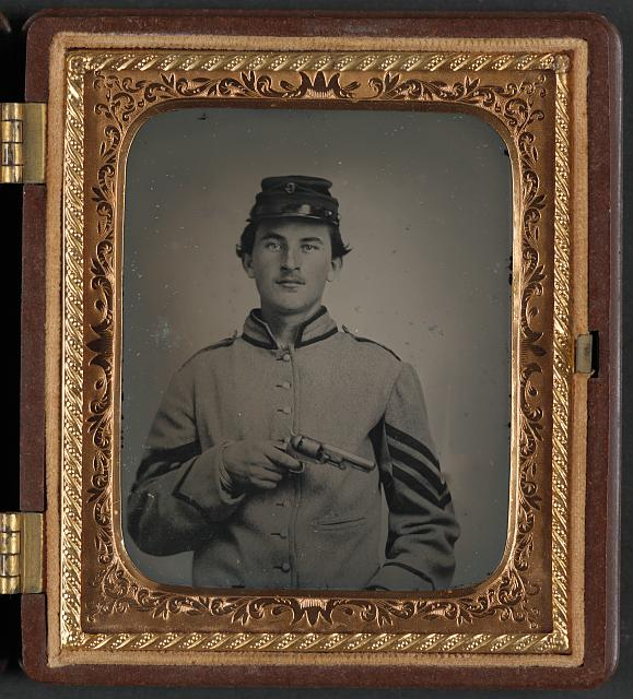[Unidentified sergeant in Confederate uniform and Company G hat with revolver]
