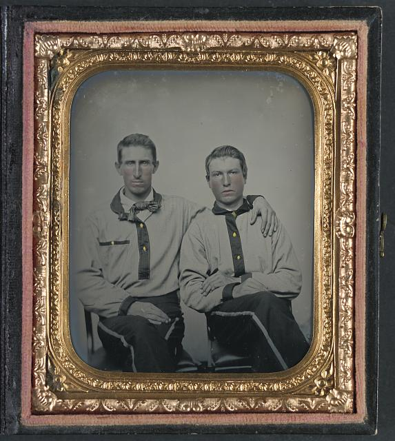 [Two unidentified soldiers in Confederate battle shirts]